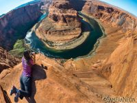 Looking down Horseshoe Bend with binobulars